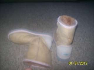 Well worn womens Ugg boots trashed Pink