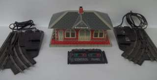 presents this vintage Tin O Scale Train Set with the following