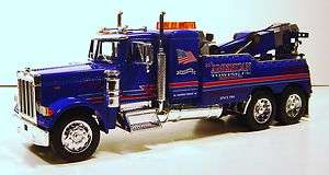 32 PETERBILT TOW TRUCK AMERICAN TOWING DIE CAST BLUE