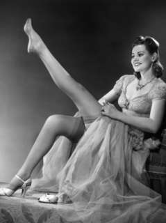 Woman in Evening Wear Pullin on Silk Stockings Photographic Print by