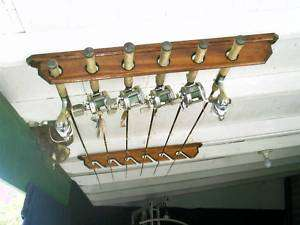 Inshore angled ceiling 6 rod rack pole holder display