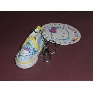 Mini Blue Hello Kitty Shoe with Music Notes Keychain Toys
